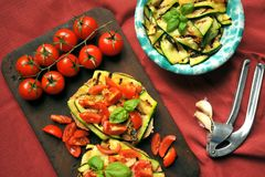 Vegan healthy food with grilled zucchini and tomato Royalty Free Stock Photos