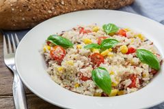 Vegan healthy salad. Quinoa and rice salad with cherry tomatoes and basil Stock Images