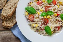 Vegan healthy salad. Quinoa and rice salad with cherry tomatoes and basil Stock Photos