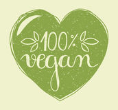 Vegan heart. Hand lettering of the text 100 percent vegan in a hand drawn green heart with grunge stamp effect royalty free illustration