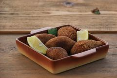 Vegan Kibbeh on Rustic Wooden Table Stock Photos