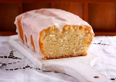 Vegan lemon cake with icing. Sliced and served royalty free stock photo