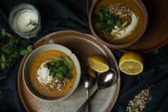 Vegan lentils soup in chiaroscuro stock images