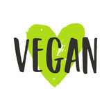 Vegan lettering and green ink heart. Vector hand drawn sign. Isolated on white Royalty Free Illustration