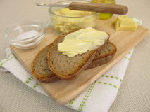 Vegan margarine on bread Royalty Free Stock Image
