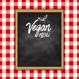 Vegan menu chalkboard on a checked cloth background Stock Image