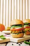 Vegan millet black bean pumpkin burgers Stock Photos