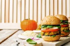 Vegan millet black bean pumpkin burgers Royalty Free Stock Images