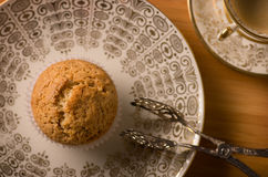 Vegan Muffin on antique Plate. Cup of Coffee and Pastry Tong Stock Photography
