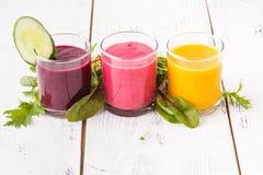 Vegan non dairy alternative milkshake. Oat flakes milk with berryes on white table stock image