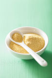 Vegan nutritional yeast flakes in bowl Royalty Free Stock Images