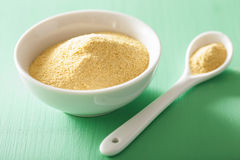 Vegan nutritional yeast flakes in bowl Royalty Free Stock Photography