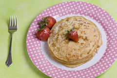 Vegan Pancakes. Made with soy milk with Strawberries on top Royalty Free Stock Photos