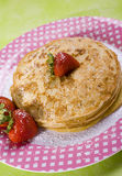 Vegan Pancakes. Made with soy milk with Strawberries on top Stock Image