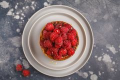 Homemade pancakes with raspberries on a gray plate, dark backgro. Vegan pancakes with raspberries and chia seeds on a gray plate, dark background, top view Stock Photography