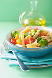 Vegan pasta with broccoli tomato carrot Royalty Free Stock Images