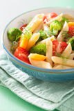Vegan pasta with broccoli tomato carrot Stock Photography