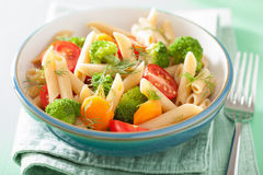 Vegan pasta with broccoli tomato carrot Stock Images
