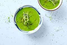 Vegan Pea Soup with pea sprouts from above Stock Photos