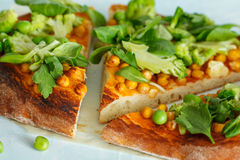 Vegan pizza with chickpeas and broccoli. royalty free stock photography