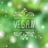 Vegan product label on blurred background Royalty Free Stock Photography