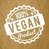 Vegan Product rubber stamp white on a crumpled paper brown background. Vegan Product rubber stamp white on a crumpled paper brown background royalty free illustration