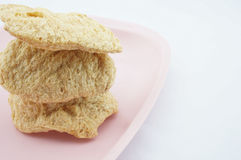 Vegan Protein Dry Stacked on pink tray. With white background Stock Photos