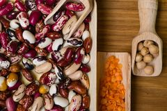 Vegan protein source. Beans, lentils, chickpea. Top view on wooden table. Healthy vegetarian food royalty free stock photography