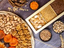 Vegan protein source. Beans, lentils, nuts and seeds. Top view on wooden table. Healthy vegetarian food stock photo