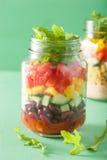 Vegan quinoa bean vegetable salad in mason jars Royalty Free Stock Images