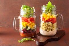Vegan quinoa bean vegetable salad in mason jars Royalty Free Stock Photography