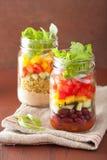 Vegan quinoa bean vegetable salad in mason jars Stock Image
