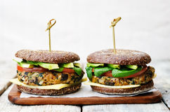 Vegan quinoa eggplant spinach chickpeas rye Burger Stock Images
