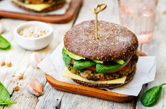 Vegan quinoa eggplant spinach chickpeas rye Burger Stock Photos