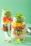 Vegan quinoa vegetable salad in mason jars Royalty Free Stock Photos