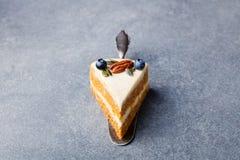 Vegan, raw carrot cake. Healthy food. Grey stone background. Copy space. stock photo