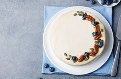 Vegan, raw carrot cake. Healthy food. Grey stone background. Top view. Copy space. Stock Image