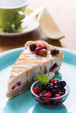 Vegan raw cheesecake with berries and lemon. Cheesecake with berries and lemon. The bottom consists of  sunflower seeds, coconut flour, almonds, date paste Royalty Free Stock Photos