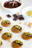 Vegan and raw pistachio cookies on white table Stock Images
