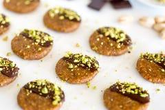 Vegan and raw pistachio cookies on white table Stock Photos