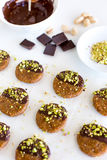 Vegan and raw pistachio cookies on white table Royalty Free Stock Images