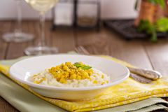 Vegan risotto with baked corn Stock Photo