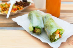 Vegan rolls on a paper plate Stock Image
