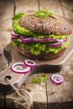 Vegan rye burger with fresh vegetables Stock Photography