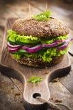 Vegan rye burger with fresh vegetables Stock Image