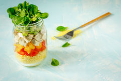 Vegan salad with couscous, tofu and vegetables in a jar. royalty free stock images