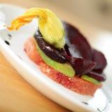 Vegan salad with garnish. Fresh, light and healthy vegan salad with pumpkin flower garnish stock photography