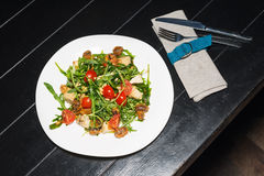 Vegan salad with tomatoes, arugula and pine nuts. Vegan salad with tomatoes, arugula, mushrooms and pine nuts stock images