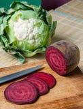 Vegan Salami, joking slices of red beet and cauliflower Stock Photo