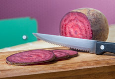 Vegan Salami, joking slices of red beet Royalty Free Stock Photo